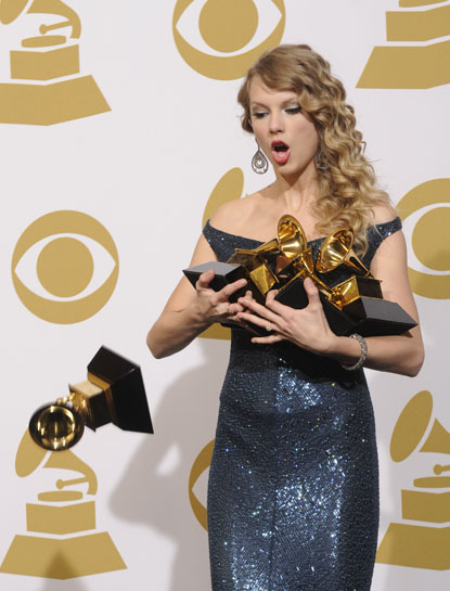 TAYLOR SWIFT WINS FOUR GRAMMYS AT THE 52ND ANNUAL GRAMMY AWARDS