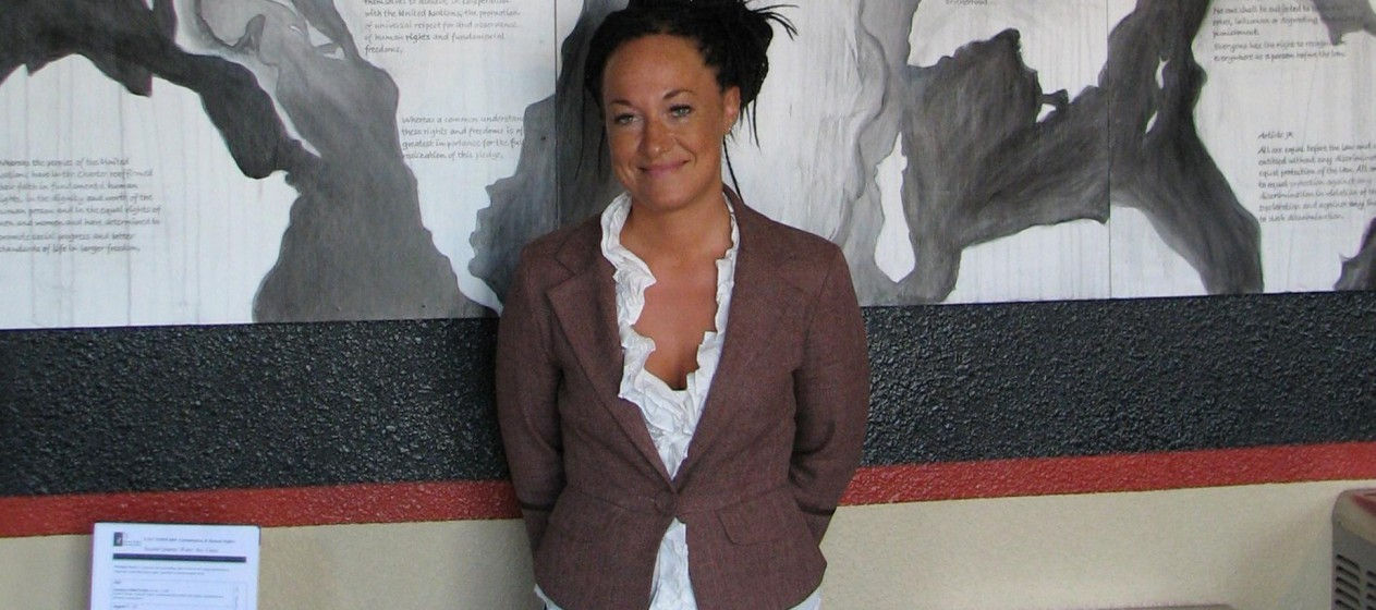 In this photo taken 24 July 2009, Rachel Doleza stands in front of a mural she painted at the Human Rights Education Institute.