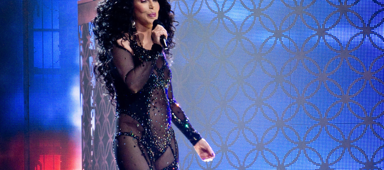 """Cher performing """"If I Could Turn Back Time"""" during the 2014 Dressed to Kill Tour."""