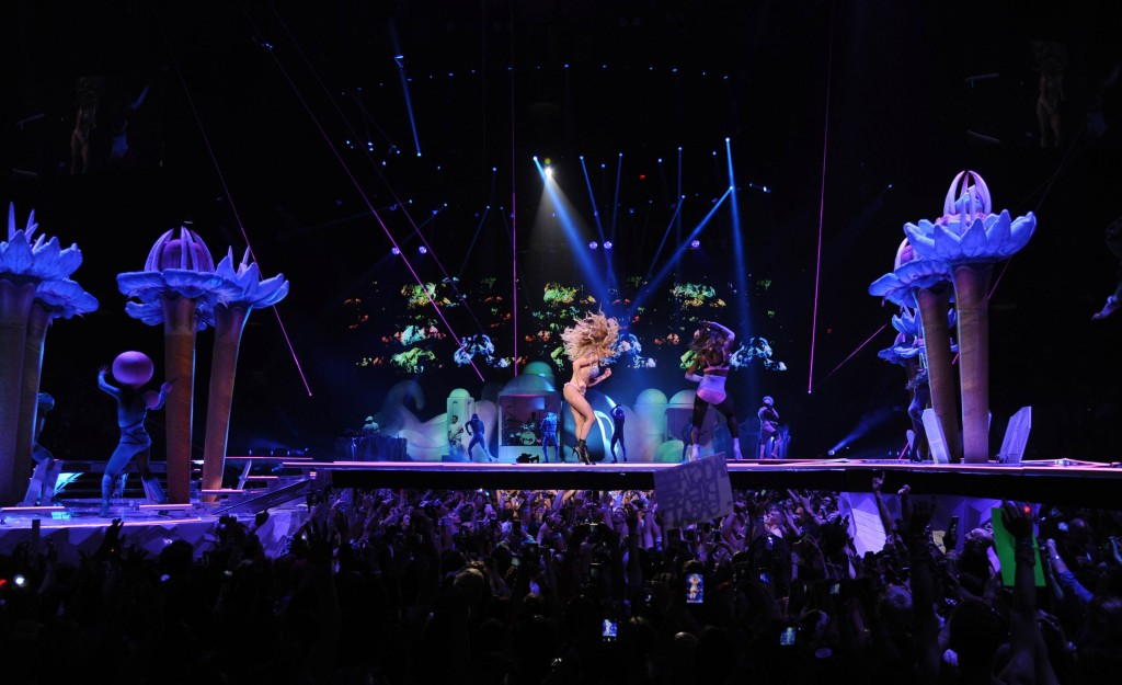 Lady Gaga performing on the ARTPOP Tour amidst inflatable stage props