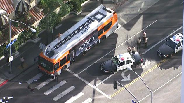 A naked man was perched on top of a Metro bus in West Hollywood on Thursday, Dec. 8, 2016.