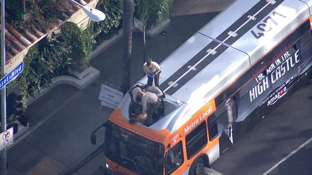 A naked man was taken into custody after posing and strutting on top of a Metro bus in West Hollywood on Thursday, Dec. 8, 2016.