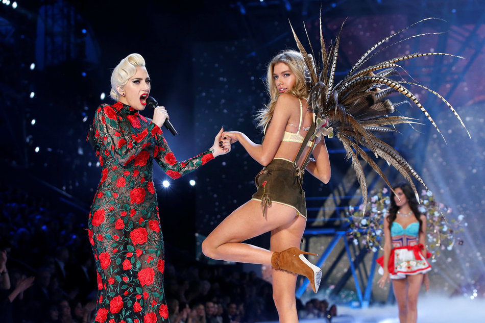 Musician Lady Gaga performs with model Stella Maxwell during the 2016 Victoria's Secret Fashion Show at the Grand Palais in Paris