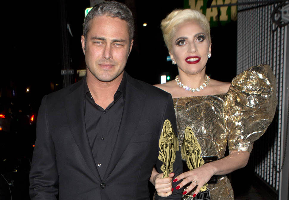 Lady Gaga clutches her Fishies with fiancé Taylor Kinney outside the Taco Bell on N Cedar Ave. in Fresno, California